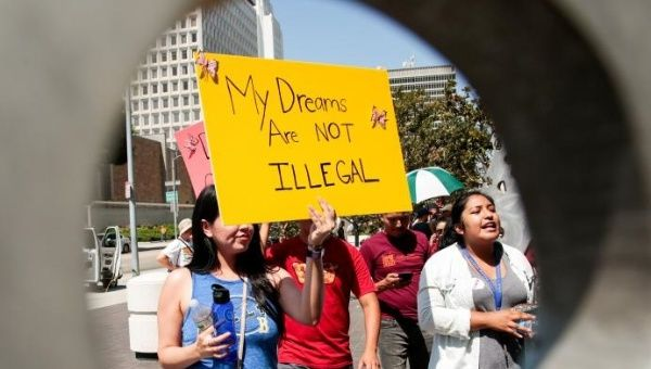 Protesters gather to show support for the Deferred Action for Childhood Arrivals (DACA) program recipient during a rally outside the Federal Building in Los Angeles, California, U.S., September 1, 2017
