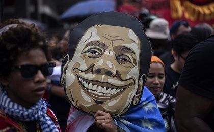 An activist holds a mask of Philippine President Rodrigo Duterte outside the Malacanang palace in Manila, Sept. 21, 2017.