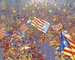 Catalans rally and hold up independence flags in Barcelona.