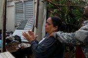 A woman surveys the damage at her mother's house in Guayama, Puerto Rico