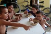 Honduran children eat at the Todo por Ellos shelter in Tapachula.