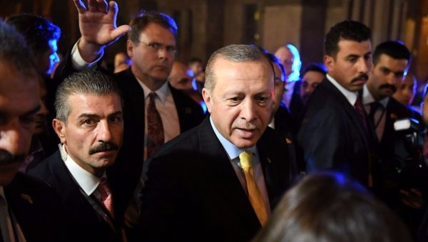 Turkish President Tayyip Erdogan shakes the hand of a supporter outside of The Peninsula hotel in Manhattan, New York, Sept. 20, 2017.
