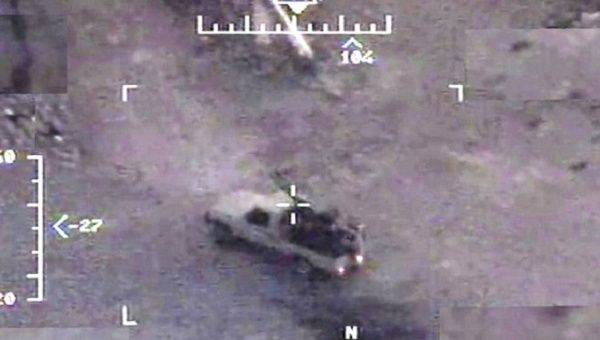 A truck is seen in the crosshairs of a Predator drone.