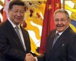 Cuba's President Raul Castro (R) shakes hands with China's President Xi Jinping.