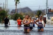 People wade through a flooded street in San Juan after Hurricane Maria.
