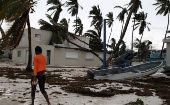 A woman walks among debris on the seashore in the aftermath of Hurricane Maria in Punta Cana, Dominican Republic.