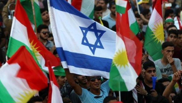 Iraqi Kurds fly an Israeli flag and Kurdish flags during an event to urge people to vote in the upcoming independence referendum.