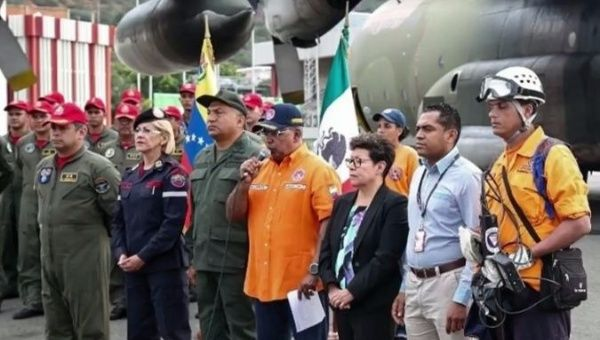 Venezuelan and Mexican officials gather at the airport.