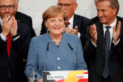 Christian Democratic Union (CDU) party leader and German Chancellor Angela Merkel reacts on first exit polls in the German general election (Bundestagswahl) in Berlin, Germany,