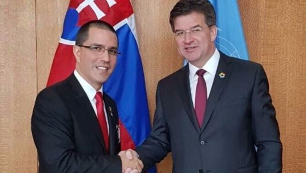 United Nations General Assembly President Miroslav Lajcak (R) and Venezuelan Foreign Minister Jorge Arreaza (L) in New York City, Sept. 25, 2017.