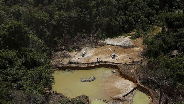 An illegal gold mine is seen on Indigenous land in the heart of the Amazon Rainforest, in Roraima State