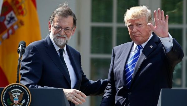 U.S. President Donald Trump (L) and Spanish Prime Minister Mariano Rajoy (L) give a joint news conference at the White House.