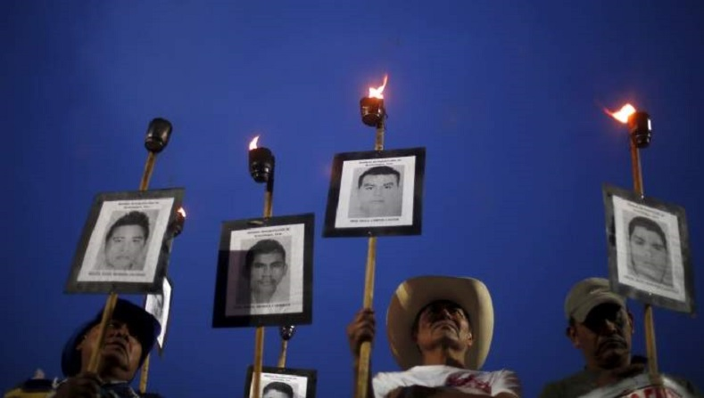 Relatives hold up posters in support of the 43 disappeared students from the Ayotzinapa teacher training college during a rally in Mexico City.