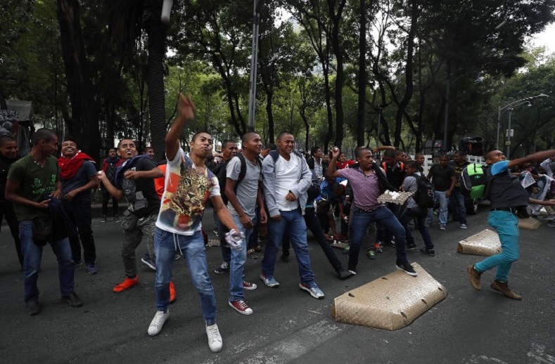 Friends and other students protesting during an anniversary march in Mexico City.