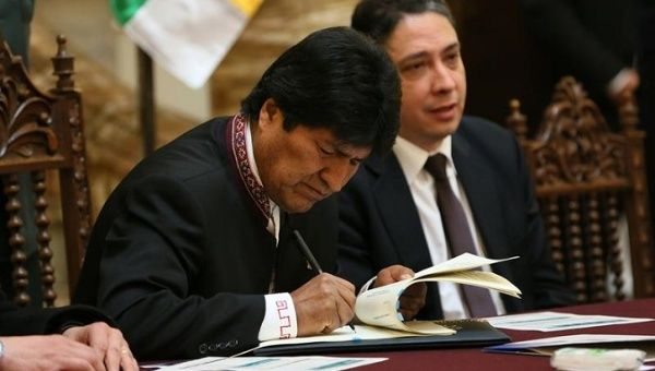 Morales signed the new statute during a ceremony at Government Palace in La Paz.