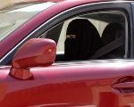 A woman drives a car in Saudi Arabia in 2013 file photo.