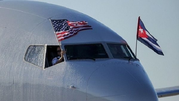 An American Airlines plane displays U.S. and Cuban national flags upon landing at Jose Marti International Airport.