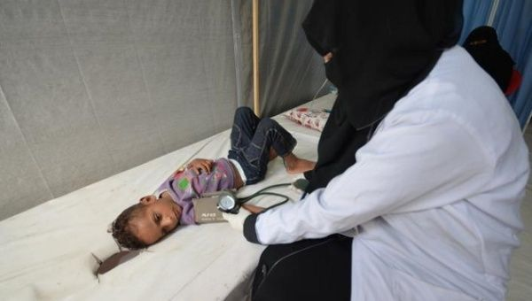A child suffering from cholera, which causes life-threatening dehydration, is treated in Yemen.