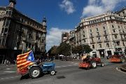 Farmers drive their tractors through Barcelona streets in support of Catalonia's independence vote.