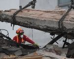 Rescuers keep working on recovery of victims from the deadliest building collapse in Mexico's September 19 earthquake, at a building on Alvaro Obregon street