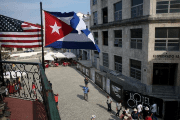 U.S. and Cuban flags hang on the terrace of a restaurant in downtown Havana, March 17, 2016.