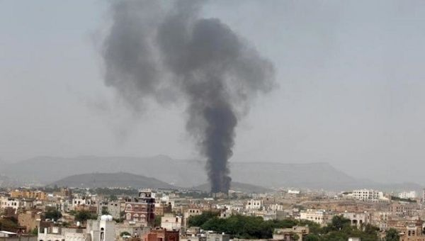 Smoke rises from a snack food factory after a Saudi-led air strike hit it in Sanaa, Yemen.