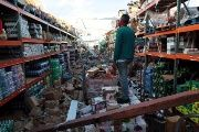 A man stands inside of a destroyed supermarket by Hurricane Maria in Salinas, Puerto Rico, September 29, 2017