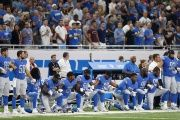 Detroit Lions players kneeling during the national anthem last Sunday.