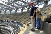Construction workers inspect the new baseball stadium which will be the largest in South America.