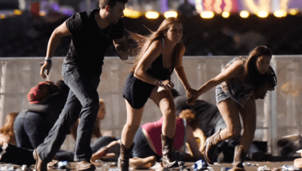 People run from the Route 91 Harvest country music festival after gun fire (