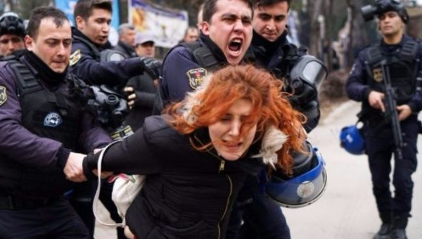Riot police detain a demonstrator during a protest against the dismissal of academics from universities outside the Cebeci campus in Ankara, Turkey.
