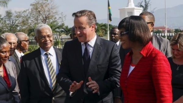 Former British Prime Minister David Cameron, whose family owned enslaved Africans and was compensated by the government when the practice was outlawed in 1833.