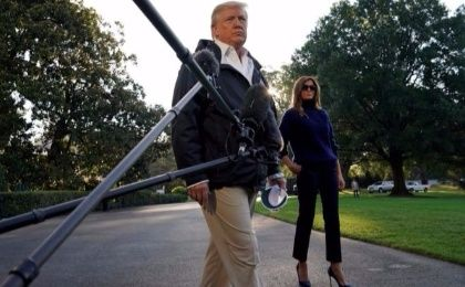 U.S. President Donald Trump and first lady Melania Trump depart the White House in Washington, U.S., on their way to view storm damage in Puerto Rico.