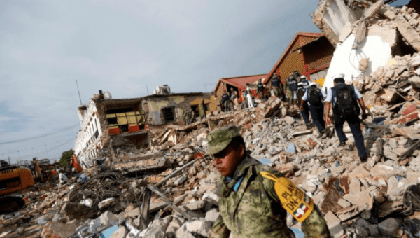 Soldiers work to remove the debris of a house destroyed in an earthquake that struck off the southern coast of Mexico.