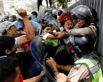 Opposition protesters attack Venezuelan police during their four months of violence.