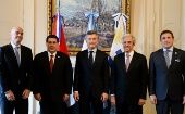 Presidents of Paraguay Horacio Cartes, Argentina Mauricio Macri and Uruguay Tabare Vazquez pose with FIFA President Gianni Infantino and Conemebol President Alejandro Dominguez in Buenos Aires.