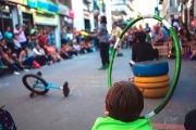 A child watches a street performance in Loja, Ecuador.