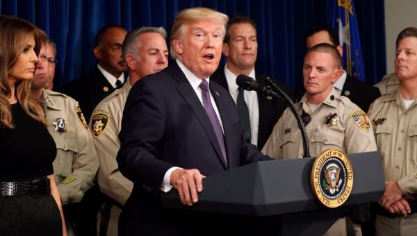 U.S. President Donald Trump speaks next to first lady Melania Trump after meeting officers at the Las Vegas Metropolitan Police Department, Las Vegas, Nevada, U.S., October 4, 2017.