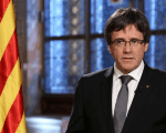 The Catalan president, Carles Puigdemont has accused the King of being a government mouthpiece