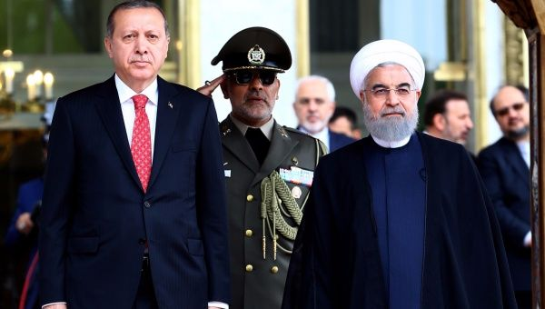 Turkish President Tayyip Erdogan is seen with Iranian President Hassan Rouhani during a welcoming ceremony in Tehran, Iran, Oct. 4, 2017.