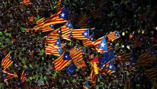 Esteladas (Catalan separatist flags) are waved as thousands of people gather for a rally on Catalonia