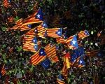Esteladas (Catalan separatist flags) are waved as thousands of people gather for a rally on Catalonia's national day 'La Diada' in Barcelona, Spain.