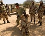 A U.S. Special Forces soldier demonstrates how to detain a suspect during Flintlock 2014, a US-led international training mission for African military officials in Diffa, Niger.