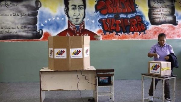 A woman casts her vote at a polling station during the Constituent Assembly election in Caracas, Venezuela.