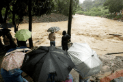 People look at the Tiribi river flooded after Tropical Storm Nate, San Jose, Costa Rica October 5, 2017.