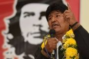 Bolivian President Evo Morales with a poster of Argentine communist revolutionary Che Guevara in the background.
