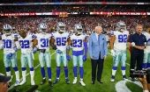 Dallas Cowboy owner Jerry Jones stands with his team before a game against Arizona Cardinals.