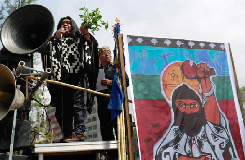 Mapuche Indian activist Victor Queipul delivers a speech against Columbus Day during a rally in downtown Santiago