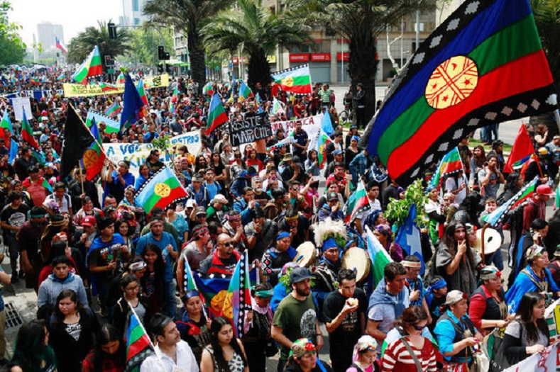 Mapuche Indian and other activists take part in a rally against Columbus Day in downtown Santiago.