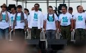 "FARC rebel leader Rodrigo Londoño, better known by his nom de guerre ""Timochenko,"" and leaders sing the national anthem during a ceremony."